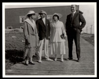Two African American couples standing on a walkway at Bruce's Beach, Manhattan Beach, circa 1920