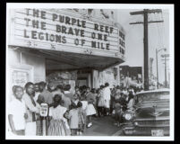 School children attending an afternoon movie at the Largo movie theater on 103rd St., Los Angeles, 1960