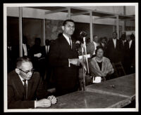 Loren Miller, seated, with Billy G. Mills and Eula English at the opening of the English Square office building, Los Angeles, 1964