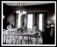 Banquet table set for an anniversary celebration of Drs. John and Vada Somerville, between 1944-1950