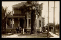 William Roberts, A. J. Roberts and Frederick Roberts on the steps of A. J. Roberts son & Co funeral home, Los Angeles, 1905-1915