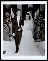 African American couple on their wedding day, likely at the First African Methodist Episcopal Church, Los Angeles, 1940s-1950