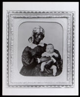 Portrait of a black early Californian woman, possibly a slave, holding a light skinned baby, possibly white, between 1850-1865