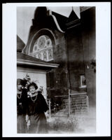 Two young African American women near a church, 1920s