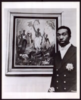 Artist standing in front of a painting, 1950-1989
