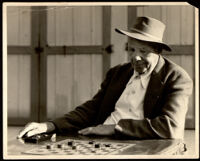 Titus Alexander playing checkers, between 1940-1952