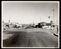 Intersection of a residential street and a major thoroughfare in south central Los Angeles, 1950s-1960s