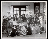 Dr. Vada Somerville and Martha Jefferson Louis with a gathering of women in a home, Los Angeles, 1940s