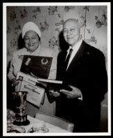 Lorenzo Bowdoin with Theresa Lindsay receiving an award from the Women's Sunday Morning Breakfast Club, Los Angeles, 1962