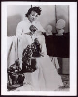 Beulah Woodard with six sculptures that she made, 1935-1955