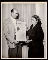 Gordon Hahn presenting a scroll to Pearl Hinds Roberts honoring her husband, Frederick Roberts, Los Angeles, circa 1957