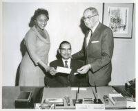 Dr. H. Claude Hudson, president of Broadway Federal Savings and Loan, with Peter W. Dauterive, Los Angeles,1960s