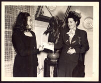 Nona Moffatt, President of Omega Sigman, presents a scholarship to a young woman, Berkeley (?), 1946