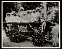 Ten young women in the horse-drawn Maryland Hotel float at the Tournament of Roses parade, Pasadena, 1908