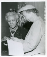 Dr. Vada Somerville conferring with Eleanor Roosevelt at a reception in the Somerville home, Los Angeles, 1950
