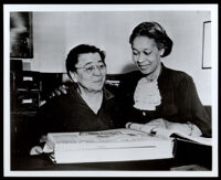 Charlotta Bass with a scrapbook, 1952 (?)