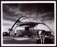 Paul R. Williams with the Theme Building at Los Angeles International Airport behind him, Los Angeles, circa 1961