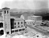 Royce Hall and Chemistry Building (Haines Hall) under construction, 1928