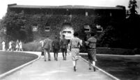 Vermont Avenue campus - Students walking toward the Women's Gymnasium, c.1928
