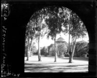 Vermont Avenue campus - Millspaugh Hall framed by North Hall arch, 1928
