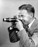 Thelner Hoover - Portrait taking photograph, c.1935