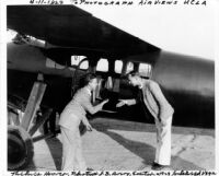 Thelner Hoover and J. Brewer Avery posing with airplane, 1929