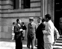 Dedication ceremony - Ernest C. Moore talking with three ASUCLA officers, 1930