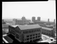 Aerial view of Chemistry Building (Haines Hall) with Library (Powell Library) and Royce Hall in background, 1930