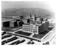 Aerial view of Physics-Biology Building (Humanities Building) with Library (Powell Library) and Royce Hall in background, 1930