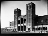 Royce Hall with students moving between classes, 1930
