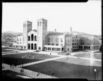 Royce Hall with students moving between classes on the Esplanade, 1930