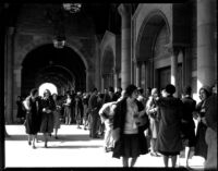 Registration - Students walking through Royce Hall colonnade, 1930