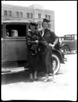 Two female students in commencement gowns, c.1930