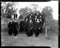 Commencement - Graduates led by faculty descending stairs, c.1941