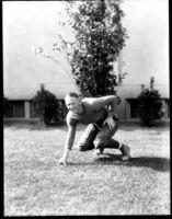 Football player posing, c.1928