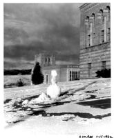 Snowfall on campus - Snowman in front of Education Building (Moore Hall), 1932.