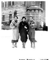 Snowfall on campus - Three female students standing in front of Education Building (Moore Hall), 1932