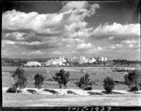 Distant view of campus with Gayley Avenue in foreground, 1937