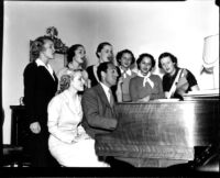 George Gershwin and students singing at the piano, 1937