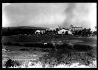Distant view of baseball game with campus in background, 1946