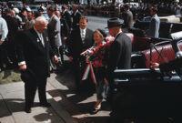 President Dwight Eisenhower and Premier of the Soviet Union Nikita Khrushchev watch Khrushchev's wife Nina Petrovna exit car during Khrushchev's September 1959 visit to Washington D.C.