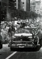 President Eisenhower shields himself from confetti during a parade