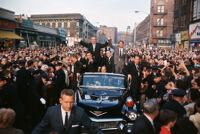 President Lyndon Johnson and Attorney General Robert F. Kennedy greet a crowd during Kennedy's senatorial campaign parade through Brooklyn, New York