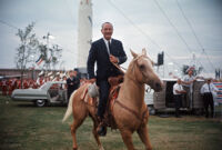 President Lyndon B. Johnson rides a horse during a 1964 presidential campaign event