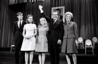 President Richard Nixon waves to crowd while accepting an award with First Lady Patricia Nixon, daughters Tricia and Julie, and unidentified man