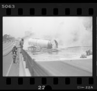 Tanker truck sprawled across 405 freeway spilling molten sulfur in Culver City, Calif., 1986