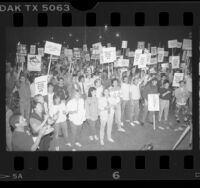 "Demonstrators with signs reading ""LaRouche Public Health Enemy #1,"" protesting AIDS Initiative, Calif., 1986"