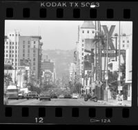 Buildings and traffic on Hollywood Blvd. near Bronson Street in Hollywood (Los Angeles), 1986