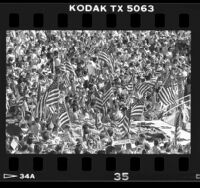 Flag-waving crowd at GOP rally in the Pacific Amphitheater in Costa Mesa, Calif., 1986