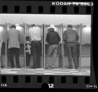 Four men in polling booths in Los Angeles, Calif., 1986